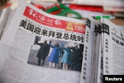 A copy of the Global Times newspaper featuring an image of U.S. President Joe Biden and Vice President Kamala Harris on its front page is seen at a news stand in Beijing, China, Jan. 21, 2021.