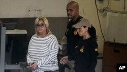 Federal agents escort former Puerto Rico Health Insurance Administration head Ángela Ávila-Marrero who was arrested in San Juan, Puerto Rico, July 10, 2019.