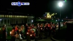 VOA60 America - Hundreds hold a candlelight march and vigil in the U.S city of Charlottesville, Virginia