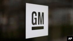 The General Motors logo at the company's world headquarters in Detroit.