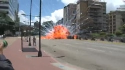Explosion as Venezuela's National Guard Troops Pass on Caracas Street