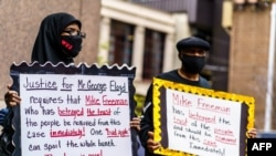 Protesters gather outside the Public Safety Facility building before former Minneapolis police officer Derek Chauvin will be charged in the death of Floyd George, in Minneapolis, Minnesota, June 29, 2020.