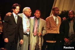 Jazz musician Ellis Marsalis (second from left) makes a curtain call with former student Harry Connick Jr. (left) and sons, Wynton, Delfeayo and Branford at Lakefront Arena in New Orleans on August 4, 2001.