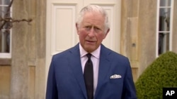 In this grab taken from video, Britain's Prince Charles addresses the media, outside Highgrove House in Gloucestershire, England, Saturday, April 10, 2021.