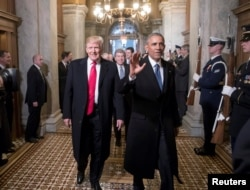 President-elect Donald Trump, left, and President Barack Obama arrive for Trump's inauguration ceremony at the Capitol in Washington, D.C., Jan. 20, 2017.