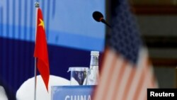 The Chinese and U.S. national flags are seen before the start of a Treaty on the Non-Proliferation of Nuclear Weapons conference with the U.N. Security Council's five permanent members, in Beijing, January 30, 2019.
