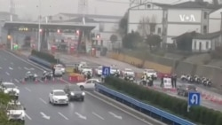 中國為遏制冠狀病毒宣佈封鎖更多城市