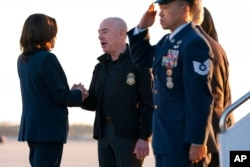 Vice President Kamala Harris greets Homeland Security Secretary Alejandro Mayorkas as she arrives to board Air Force Two, at Andrews Air Force Base, Md., en route to El Paso, Texas, June 25, 2021.