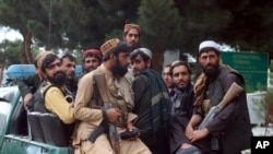 Taliban fighters arrive inside the Hamid Karzai International Airport after the U.S. military's withdrawal, in Kabul, Afghanistan, Aug. 31, 2021.