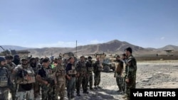 FILE - Afghan commandos arrive to reinforce security forces in Faizabad, capital of Badakhshan province, after the Taliban captured neighborhood districts of Badakhshan recently, July 4, 2021.