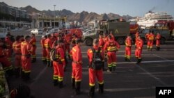 Members of the Spanish Army Emergency Military Unit prepare to travel by boat from Tenerife to the island of Gran Canaria to participate in the extinction of a new forest fire in the town of Valleseco on August 17, 2019. Authorities in the Spanish…