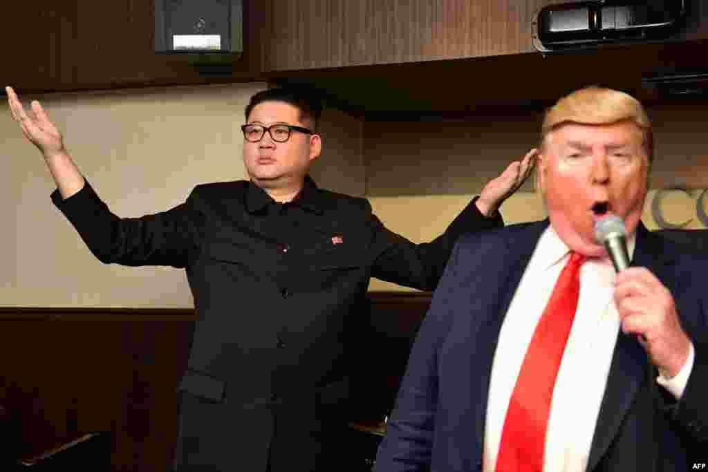 Impersonators of North Korean leader Kim Jong Un (L) and U.S. President Donald Trump perform at a bar in Osaka, Japan, ahead of the G-20 summit.