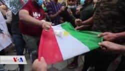 دیمەنی سوتاندنی بارەگای لقی 5 ی پارتی دیموکراتی کوردستان لە بەغدا لەلایەن لایەنگرانی حەشدی شەعبدی