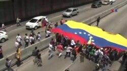 Minlərlə venezuelalı prezidentin istefasını tələb edir