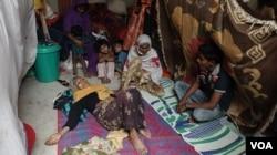 A sick Rohingya woman lying inside an unidentified Rohingya refugee camp in West Bengal. Until December (2020) over 500 Rohingya refugees lived in West Bengal. (Shaikh Azizur Rahman/VOA)