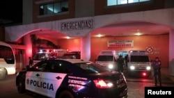 A police patrol car is seen outside a hospital where injured inmates were taken following a shootout among inmates at La Joyita prison, in Panama City, Panama, Dec. 17, 2019.