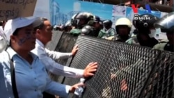 Opposition Officials Charged After Tuesday's Violence