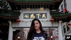 """Emerson College student Frances Hui poses in the Chinatown neighborhood of Boston, Oct. 2, 2019. Hui, of Hong Kong, faced threatening language from classmates from mainland China after she published a column, """"I am from Hong Kong, not China."""""""