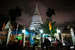Locals wait in line overnight for free coronavirus testing at Wat Phra Si Mahathat temple in Bangkok, Thailand, Friday, July 9, 2021.