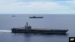 USS Ronald Reagan ႏွင့္ USS Nimitz ေလယာဥ္တင္သေဘၤာႀကီး တို႔ စစ္ေရေလ့က်င့္ေနစဥ္ (မွတ္တမ္းဓါတ္ပံု-၂၀၂၀ ဇူလိုင္လ ၇ ရက္ေန႔)