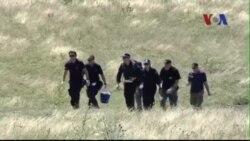 Điều tra viên khởi sự làm việc tại hiện trường máy bay MH17 rơi