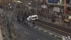 Protesters Overturn Iranian Police Van
