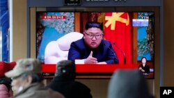 FILE - People watch a TV broadcast showing a news program reporting about North Korean leader Kim Jong Un with a file image if him, at the Seoul Railway Station in Seoul, South Korea, April 21, 2020.