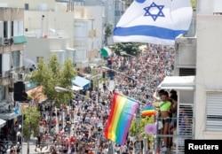 FILE - Revellers take part in an annual gay pride parade in Tel Aviv, Israel. June 14, 2019.