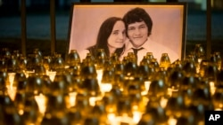 A memorial in Bratislava, Slovakia, for murdered journalist Jan Kuciak and his girlfriend, Martina Kusnirova, is seen in this Feb. 28, 2018, photo.