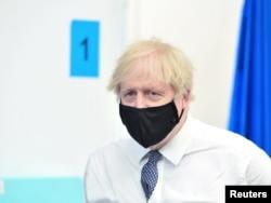 FILE - Britain's Prime Minister Boris Johnson visits a coronavirus vaccination site at the Business Design Centre in Islington, London, Britain, May 18, 2021.