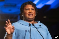 FILE - Georgia Democratic gubernatorial candidate Stacey Abrams addresses supporters during an election night watch party in Atlanta, Nov. 6, 2018.