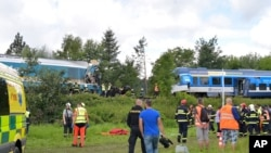 The Western Express Train collided with a passenger train near the village of Milavce between the stations Domazlice and Blizejov, Czech Republic, Aug. 4, 2021.