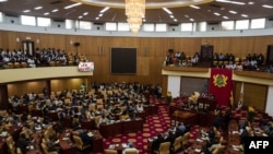 FILE - Lawmakers gather at Ghana's parliament, in Accra, July 31, 2019.