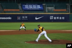 Chinatrust Brothers players during a game against Fubon Guardians with no audience at Xinzhuang Baseball Stadium in New Taipei City, Taiwan, April 24, 2020.
