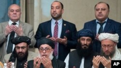 "Taliban political chief Sher Mohammad Abbas Stanikzai, first row second from left, Abdul Salam Hanafi and other Taliban official pray during the ""intra-Afghan"" talks in Moscow, Russia, Wednesday, Feb. 6, 2019. The U.S. has promised to withdraw half…"