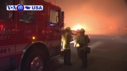 VOA60 America - hot and windy conditions are causing wildfires to spread through northern Los Angeles