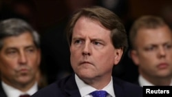 FILE PHOTO: White House Counsel Don McGahn listens to Judge Brett Kavanaugh as he testifies before the Senate Judiciary Committee during his Supreme Court confirmation hearing in the Dirksen Senate Office Building on Capitol Hill in Washington, U.S…