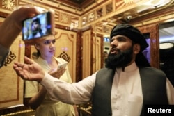 FILE - Taliban spokesmanSuhail Shaheen leaves after a news conference in Moscow, Russia, July 9, 2021.