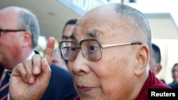 FILE PHOTO: Tibetan spiritual leader the Dalai Lama gestures as he arrives at a hotel in Darmstadt, Germany, Sept. 18, 2018.