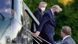 President Donald Trump arrives at Walter Reed National Military Medical Center, in Bethesda, Md., Oct. 2, 2020, on the Marine One helicopter after he tested positive for COVID-19.
