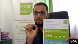 Jawad Bachare, head of a French organization fighting Islamophobia, points to statistics collected by his group that show a sharp rise in anti-Islamic acts in France in recent years. (Lisa Bryant/VOA)
