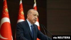 Turkish President Recep Tayyip Erdogan talks during a news conference following a coronavirus disease (COVID-19) meeting in Ankara, March 18, 2020.