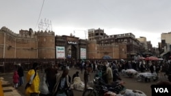 People shop outside the gates to the Old City in Sana'a on May 7, 2020.