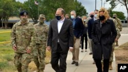 In this Sept. 9, 2020, image provided by the U.S. Air Force, is Marshall Billingslea, special presidential envoy for arms control, center, and National Nuclear Security Administration Administrator Lisa Gordon-Hagerty, right, walking with Air Force…