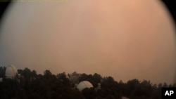 This photo provided by High Performance Wireless Research and Education Network and ALERTWildfire from a camera atop Mount Wilson shows dense smoke shrouding the famed Southern California observatory, Sept. 16, 2020.