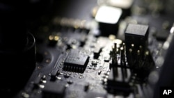 FILE - The inside of a computer is seen in Jersey City, N.J., Feb 23, 2019. A ransomware attack paralyzed the networks of at least 200 U.S. companies July 2, 2021, according to a cybersecurity researcher.
