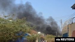 Smoke rises from fighting between Somali federal army and Jubaland state forces in Beled Hawo, in the Gedo region of Somalia, Jan. 25, 2021, in this image obtained via social media. (SHAFIE A. MAGAN @ShafiMagan)