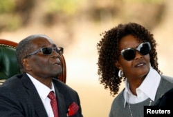 FILE - Zimbabwe's former president Robert Mugabe and his wife Grace look on after addressing a news conference at his private residence in Harare, Zimbabwe, July 29, 2018.