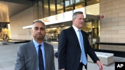 Imaad Zuberi, left, leaves the federal courthouse with his attorney Thomas O'Brien, right, in Los Angeles, on Friday, Nov. 22, 2019. Zuberi pleaded guilty to funneling donations from foreigners to U.S. political campaigns. (AP Photo/Brian Melley)