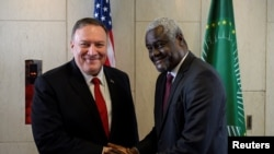 U.S. Secretary of State Mike Pompeo shakes hands with African Union Commission Chairperson Moussa Faki Mahamat at the African Union Headquarters in Addis Ababa, Ethiopia February 18, 2020. Andrew Caballero-Reynolds/ Pool via REUTERS